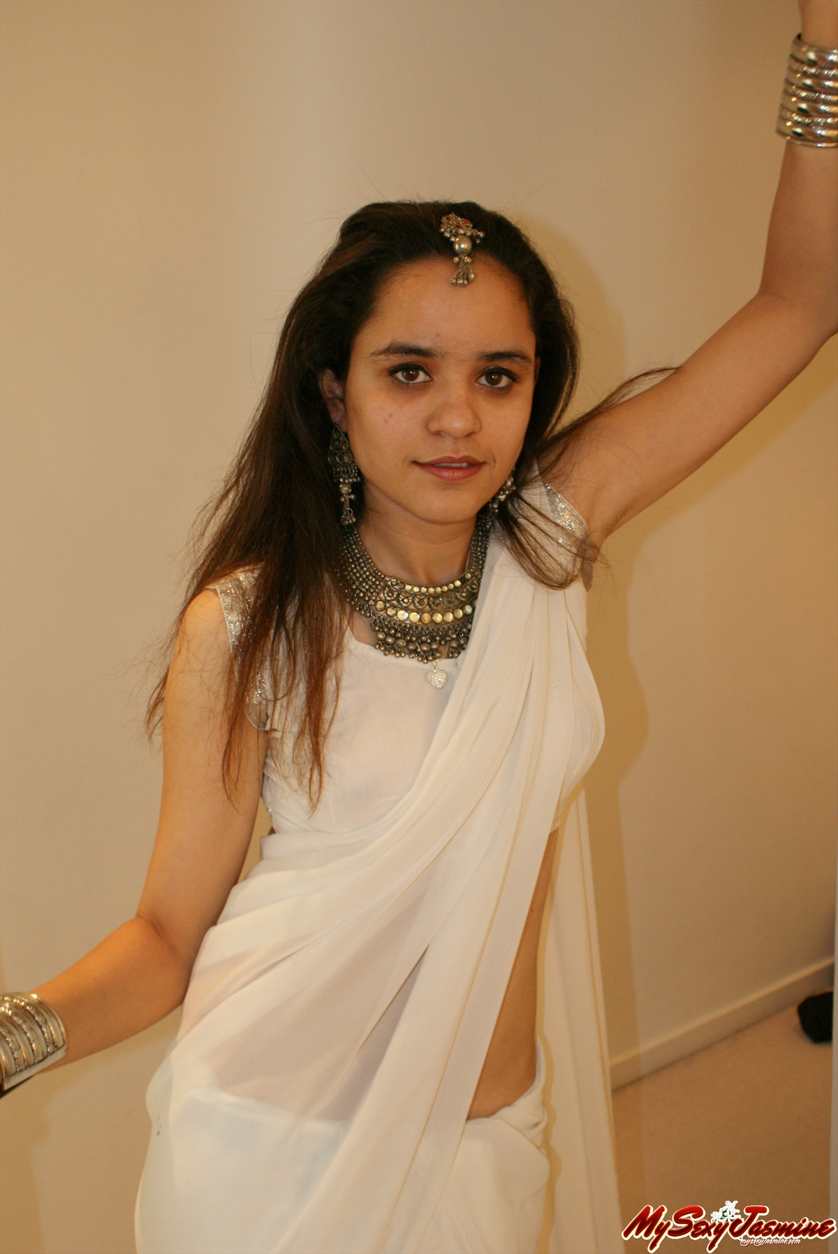 Pic gal 0026. Jasmine in white indian saree looking hot teasing her man
